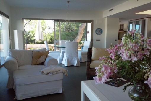 Large living area with sliding windows