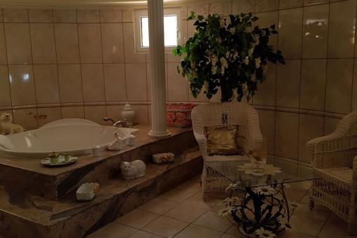 Bathroom with large bath tub