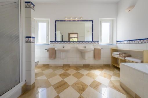 Noble bathroom with shower and bath tub